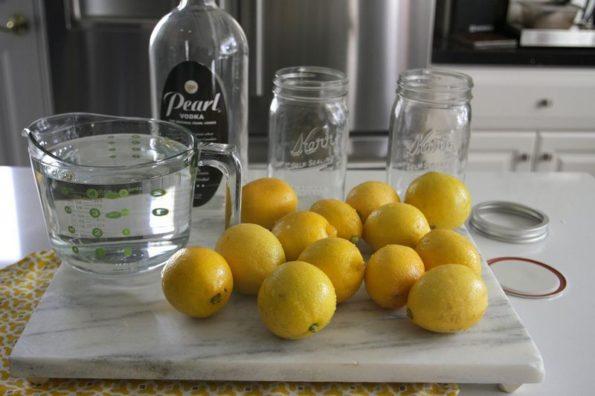 Лимоны и водка на столе